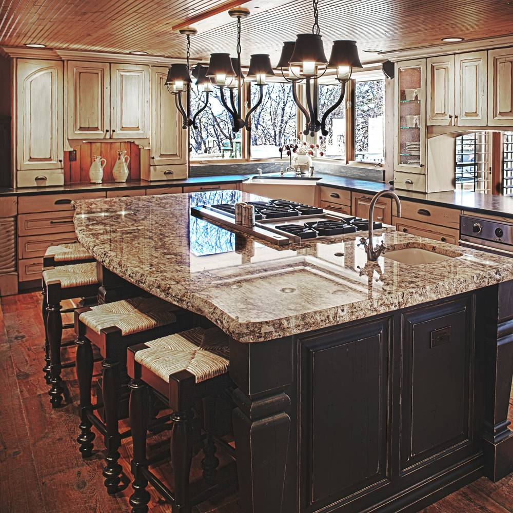 expansive marble island with stove top and sink-kitchen island designs-quinju.com