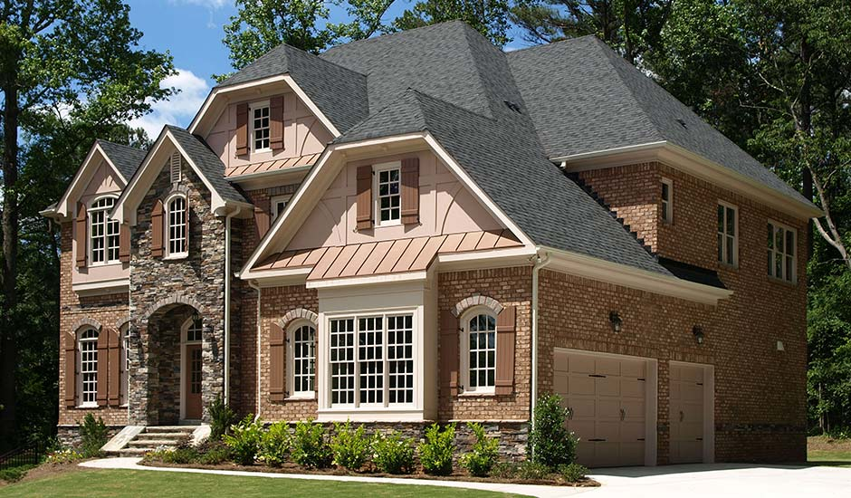 New Roof On Brick And Stone House With Brown Shutters