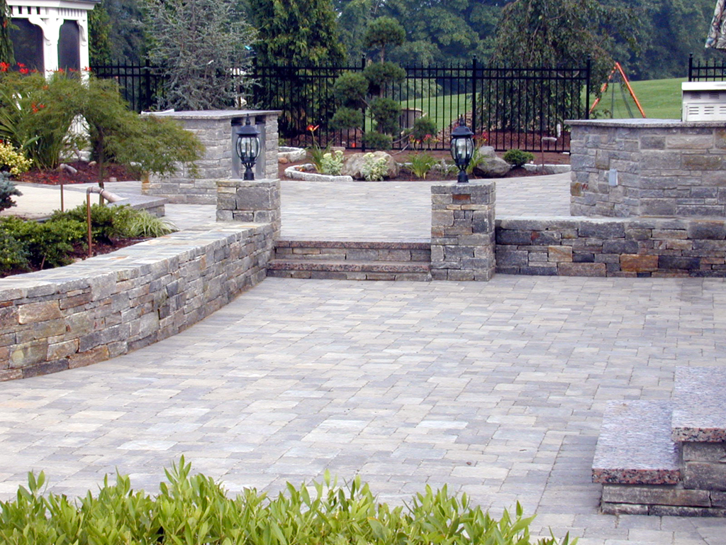 Patio stones and paver choices so many options for How to build a river rock patio